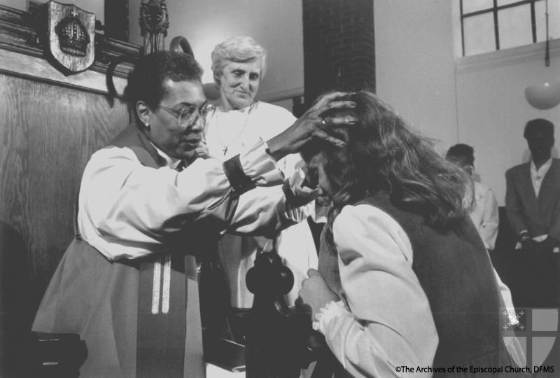 Bishop Harris Confirming A Congregant